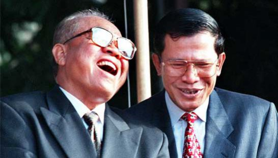 Senate President Chea Sim and Prime Minister Hun Sen share a laugh outside the Cambodian People's Party headquarters in 1999.