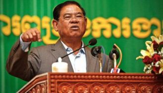 Interior Minister Sar Kheng speaks to officials on measures for suppressing demonstrations ahead of CNRP President Kem Sokha's trial at a Friday meeting in Phnom Penh.