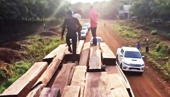 Authorities inspect a truck owned by tycoon Kith Meng's Ang & Associates that was allegedly transporting timber to Vietnam from Strung Treng province last month. Photo supplied