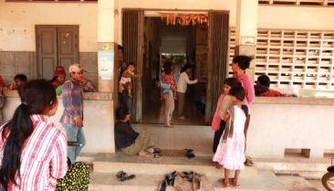 Patients queue outside a clinic in Siem Reap province.