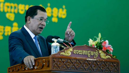 Prime Minister Hun Sen gives a speech during a presentation ceremony at the National Institute of Education