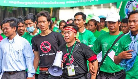 Activists and members of civil society march through the streets of Phnom Penh on International Labour Day in 2011 to protest against the NGO law.