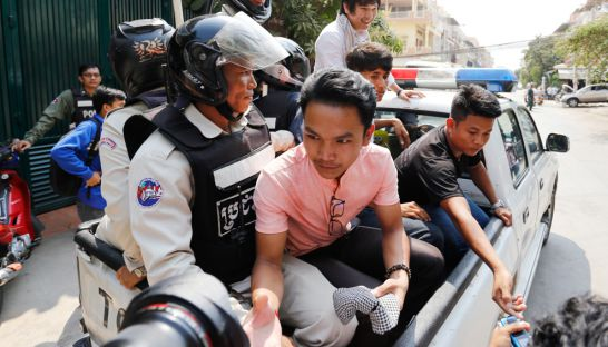 Armed police arrest four young activists after shutting down their screening of a news report on Kem Ley's murder yesterday in Phnom Penh.