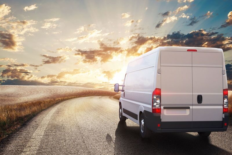 commercial van driving into the sunset