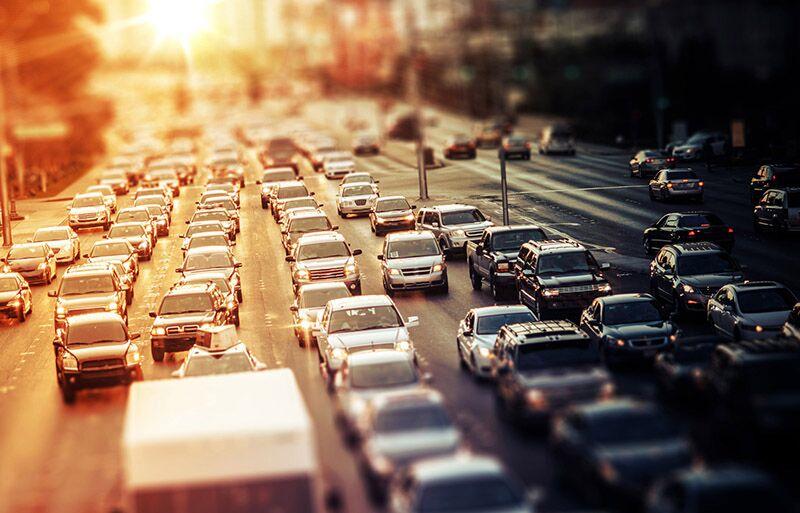 cars in the sun in traffic