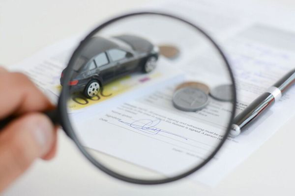 car insurance claim form with toy car
