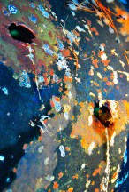 Abstract – colorful crying pareidoila face on oil drum