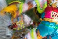 Abstract – blurred colorful costumed Peruvians perform a scissor dance