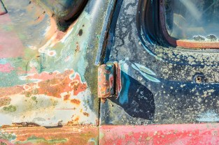 Graphic – close up of rusted, colorful paint-peeling truck cab
