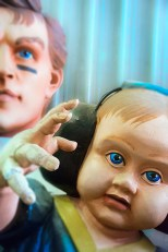 Man-Made – figures of football player and baby wearing headphones
