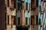 Abstract – exposed inner doorways and colorful brick walls of burned mill