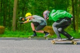 Life – two skateboarders racing to finish line