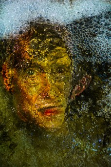 Abstract – image of John Waters under bubbling water