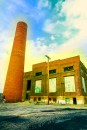 Man-made – abandoned glowing brick industrial building and smokestack