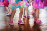 Life – little girls in colorful dresses dance