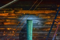 Graphic – pier piling on a background of weathered clapboards - labor