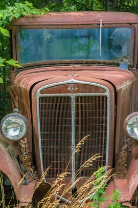 Man-made – Head on view of rusted, abandoned, antique vehicle