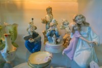 Conceptual – nostalgic pastel color ceramic porcelain posed statuette figurines
