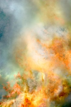 Abstract – wispy flames reach out from billows of smoke