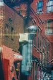 Graphic – warped, reflected image of brick walls