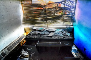 Man-Made – trashed desk and tiny office - fart