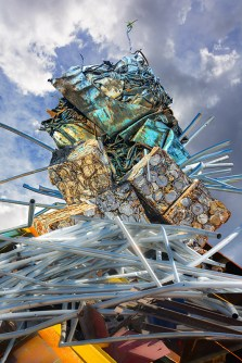 Abstract – Looking up at a tower of assorted scrap metals