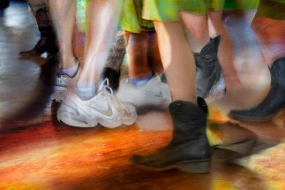 Life – blurry movement focus of dancers wearing sneakers and cowboy boots