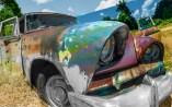 Abstract – deformed car junk yard car entity - fart