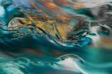 Abstract – wet reflections on rolling, undulating water