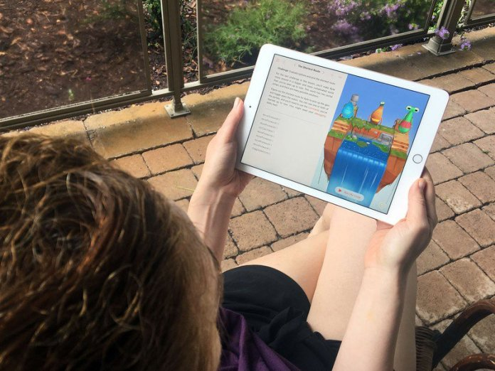 Person using Swift Playgrounds on iPad