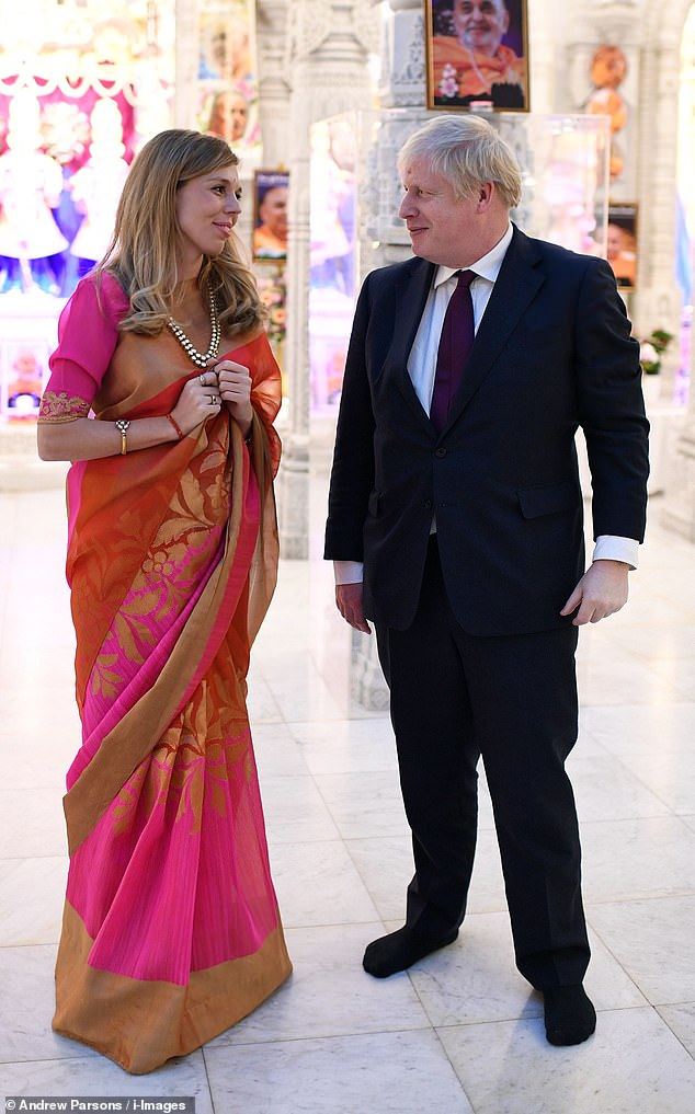 Mr Johnson stepped out last night to a temple in London with partner Carrie Symonds, 31