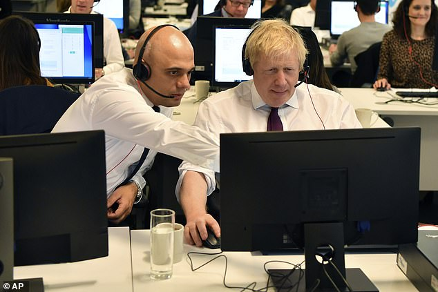 Mr Johnson spends a good while staring blankly at the computer screen while Mr Javid points to different things he is supposed to click on