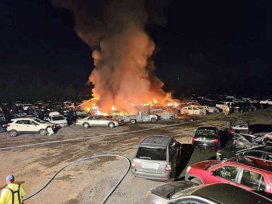 Firefighters battled a blaze at an auto storage yard where between 15 and 20 vehicles caught fire early Saturday morning on Christian Lane in Berlin. The Berlin Volunteer Fire Department said the call came in after 1 a.m. Saturday, Sept. 5, 2020. Photo: Berlin Volunteer Fire Department Photo