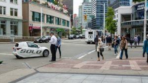 The Solo vehicle from Electrameccanica Vehicles (SOLO) drives through Vancouver.