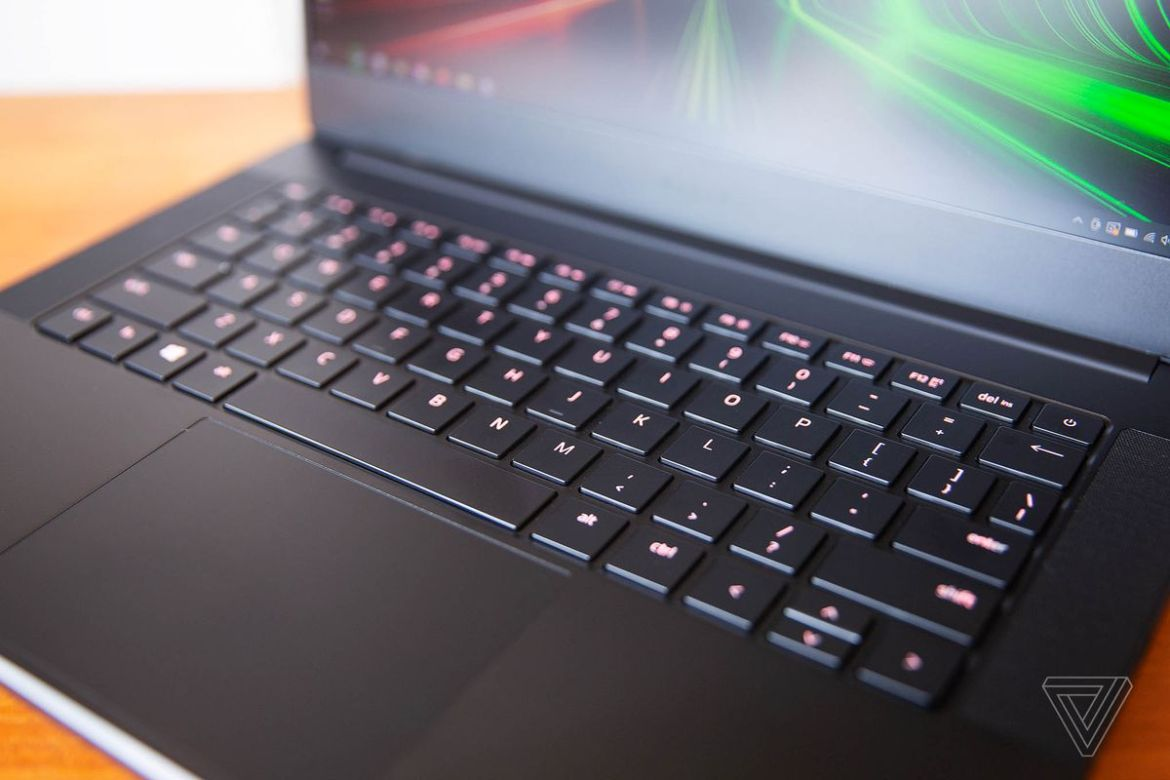 The Razer Blade 14 keyboard seen from above and to the right. The keys are lit a dark pink.