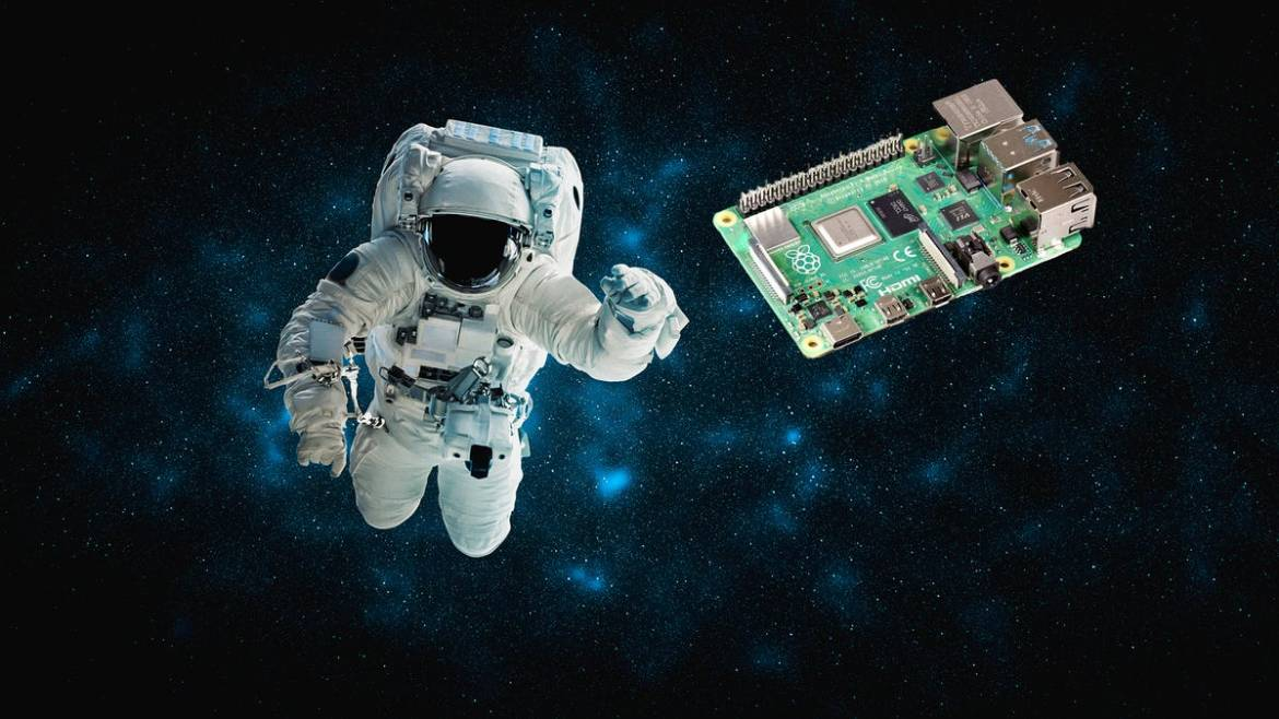 """An astronaut floating in space """"chasing"""" a Raspberry Pi"""