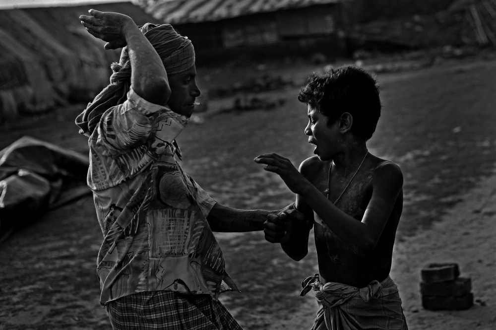 """© Md Shahnewaz Khan from the series """"Fallen Stars""""; Shafik was beaten by his master in brick field and he accused to play in working hour. Bakkar brickfield in Chittagong, Bangladesh, 2013"""