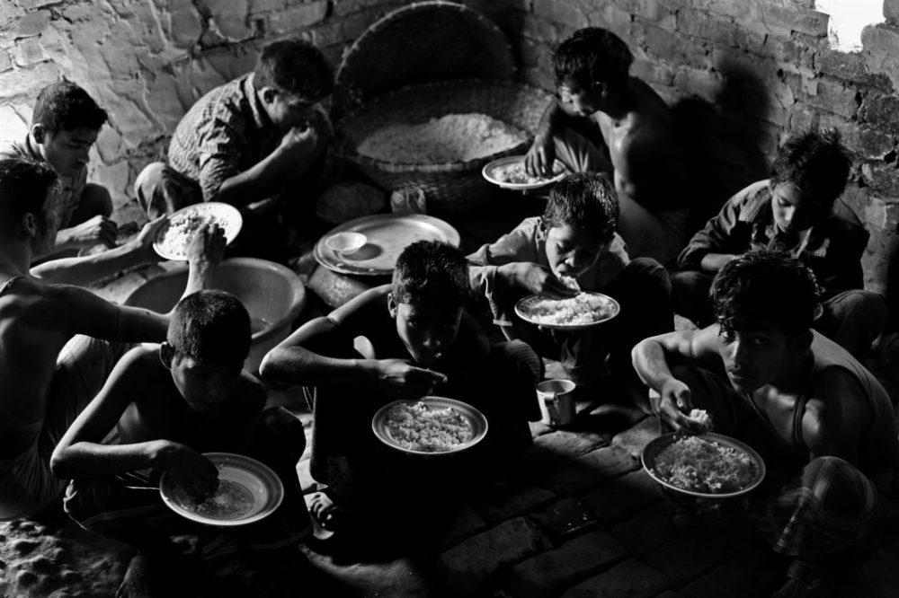 "© Md Shahnewaz Khan from the series ""Fallen Stars""; at brickfield workers have only unhealthy and very cheaper rice and vegetable for their lunch. Bakkar brickfield in Chittagong, Bangladesh, 2013"