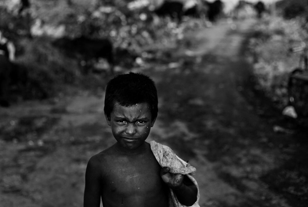 "© Md Shahnewaz Khan from the series ""Fallen Stars""; a boy of garbage dump yard. Anandabazar dump yard, in Chittagong, Bangladesh, 2013"