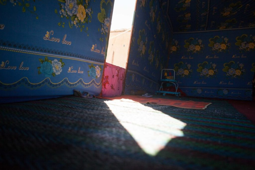 © Alan Gignoux - A ray of harsh Sahara light at the door of a refugee tent, Layounne Refugee Camp, Algeria.