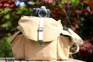 I love my Canon 5D mark iii and all my gear. But, frankly, this photo tells it all: the tested E-M10 sits on the top of my photo bag. Do you need any other evidence how small it is?