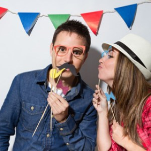 Photo booth couple with props and banner