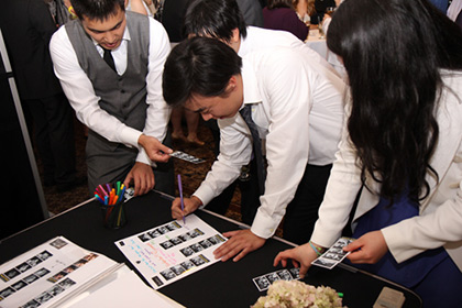 People-signing-photo-booth-scrapbook-guestbook