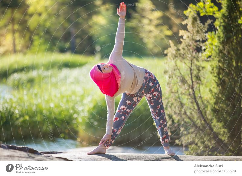Almost all types of yoga share the same foundation of poses, but there are differences. Attractive Woman In Hijab Training In The Park Meditating Doing Yoga Exercises On Fresh Air And Enjoying Early Morning Healthy Lifestyle A Royalty Free Stock Photo From Photocase