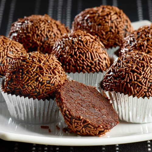 Plate of Rum chocolate truffles in silver cases - Food and drink photography