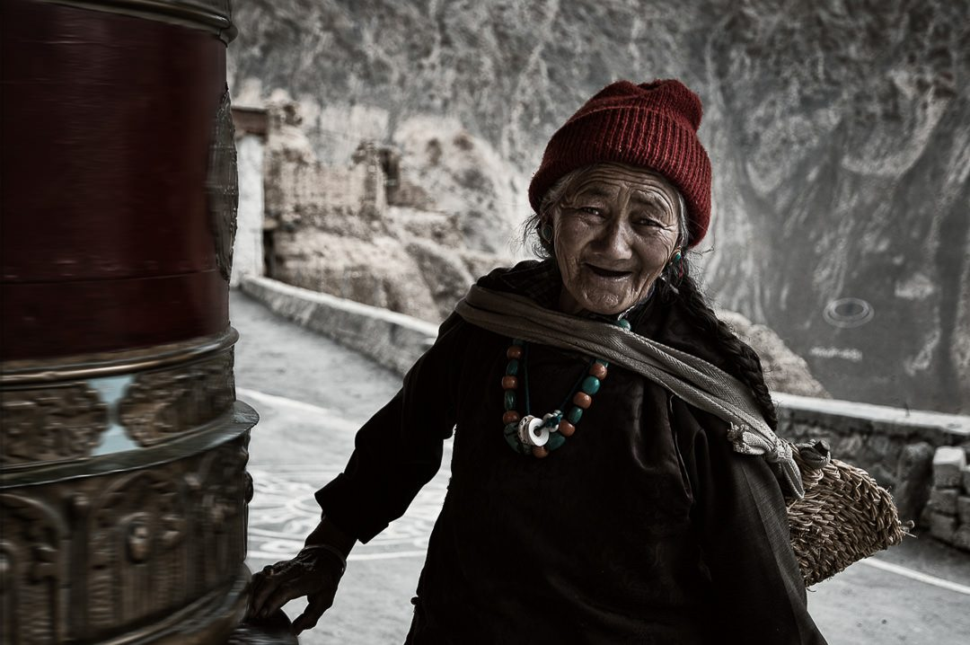 Ladakh Lady at Prayer Wheel © Hamish Scott-Brown