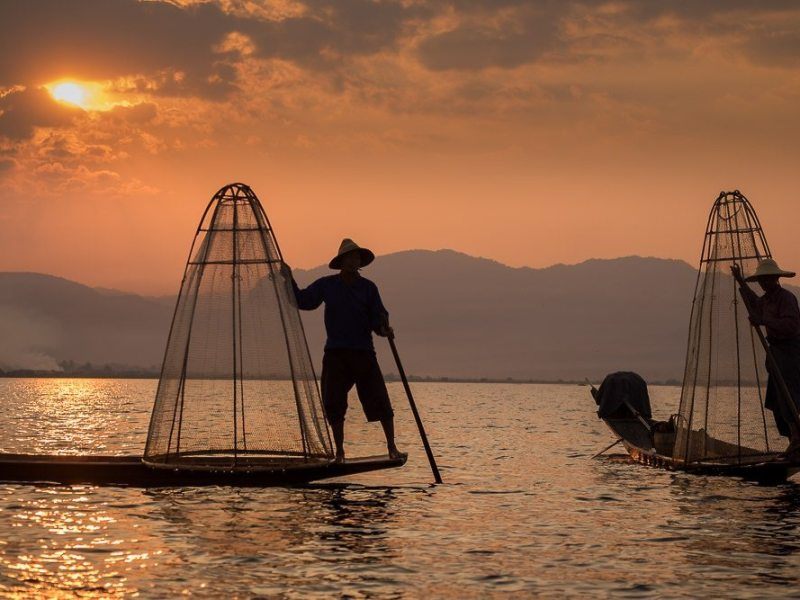 fisherman at dawn inle lake, myanmar