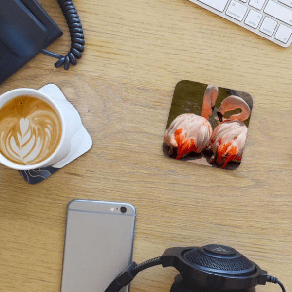 Photo Coaster - Flamingoes - Jersey - on desk with coffee and phone - by Dave Mutton Photography