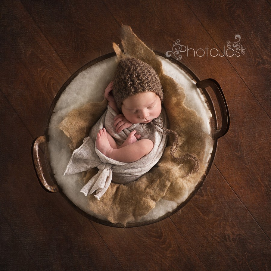 Newborn baby sleeping during a photography training workshop with Kelly Brown