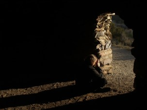 Self portrait in the coal ovens in Death Valley, California